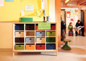 Half-cupboard for storing personal boxes.
